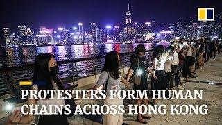 Protesters form human chains across Hong Kong
