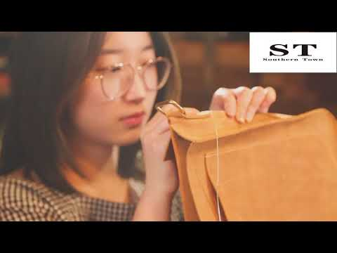 Beautiful women make handmade messenger bags with large pieces of crazy horseskin
