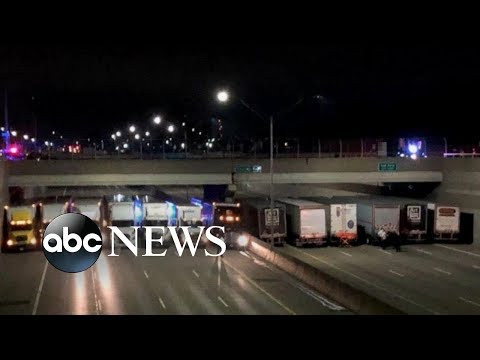 Trucks line up to help stop suicide attempt on Michigan freeway
