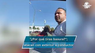 Camionero agrede con extintor automovilista que le reclamó por tirar basura
