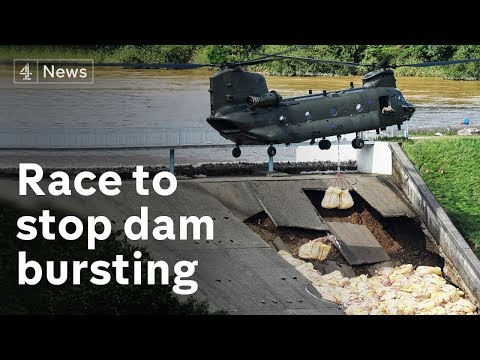 Town evacuated as dam damaged in heavy rains