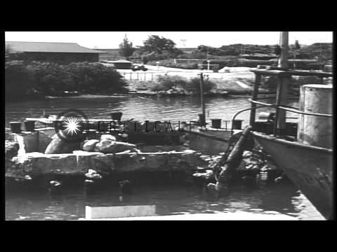 Salvage activities aboard ship and capsized hull of US Navy USS Oklahoma battlesh...HD Stock Footage