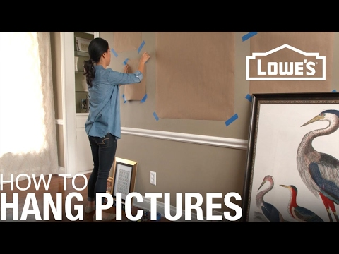 How to hang multiple picture frames without nails