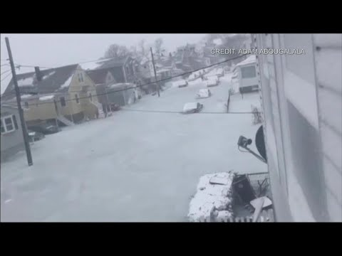 Frozen floodwaters trap vehicles in storm-battered Massachusetts