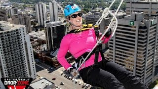 Parents Rappel Off Building For Children With Disabilities - Easter Seals Drop Zone