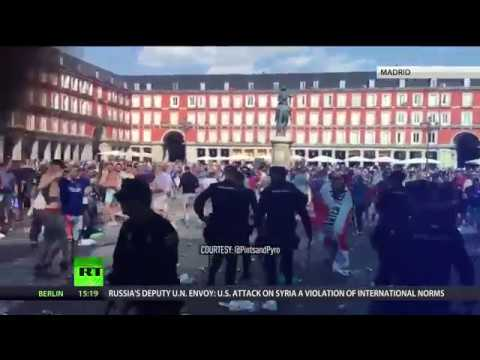'Gibraltar is ours': English football fans clash with riot police in Madrid