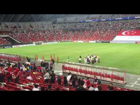 Players walking off the pitch after Singapore lost 3-0 to Bahrain