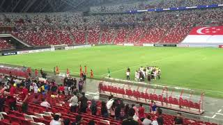 Players walking off the pitch after Singapore lost 3-0 to Bahrain screenshot 5