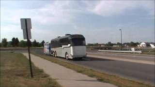 1958 Silver Eagle Bus Conversion pulling a 30 foot trailer