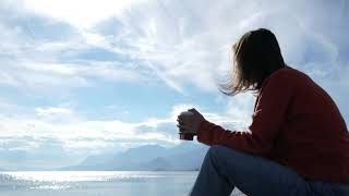 Girl take rest and enjoy nature and also enjoy cofee