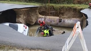 Raw: Cars Lifted After Fatal Sinkhole Accident