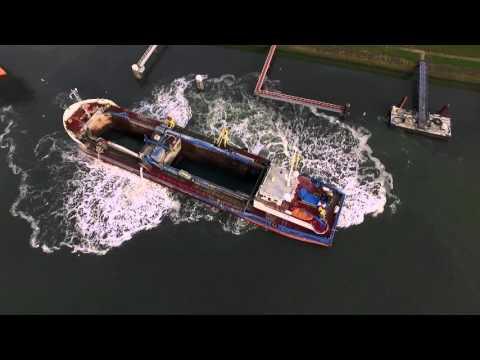 Dredger Deo Gloria dredging in Stellendam port Holland