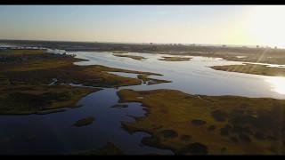 sunrise flight over the intercoastal waterway and marsh