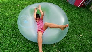 sami plays with a transparent bubble