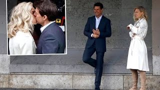 Sealed with a kiss: Tom Cruise embraces rumoured girlfriend Vanessa Kirby in Paris on MI6 set
