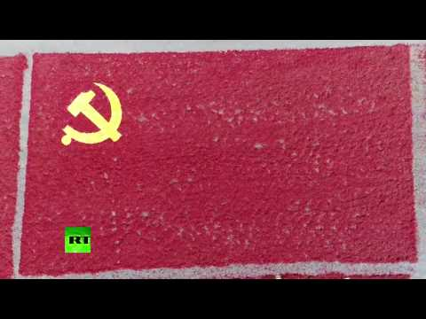 Harvest Art: Drone captures giant communist flag made out of chili peppers in China
