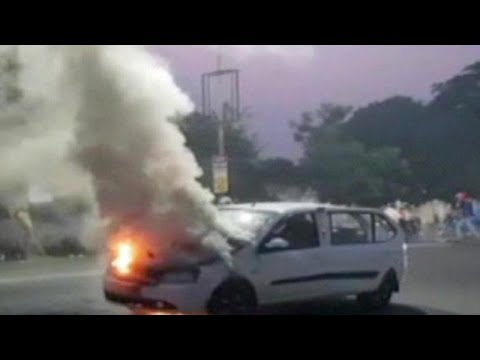 Moving car catches fire in Gujarat's Kheda