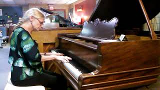 Here's one of our staff, Karen Griffin, playing the Kurtzmann parlo...