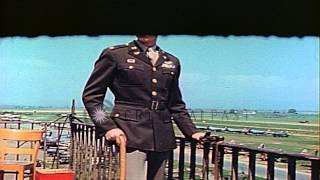 An Officer of the United States Army Air Force stands and observes from an airpla...HD Stock Footage