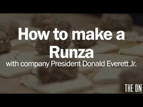Making a Runza sandwich with company President Donald Everett Jr.