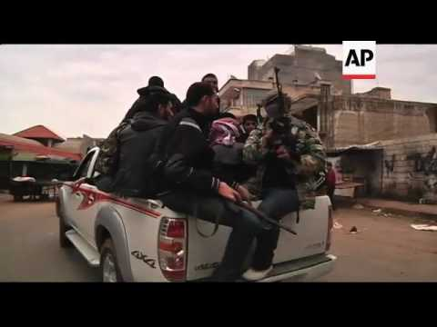EXCLUSIVE AP video of intense street fighting in Idlib; dead and wounded