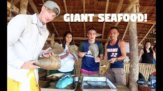 AMAZING BAMBOO FLOATING COTTAGES AND EATING GIANT SEAFOODS I...
