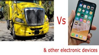 Big Rig vs. iPhone (and other electronic products)  Truck driving over stuff