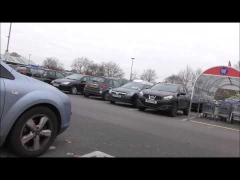 Scam, criminals try selling TVs at Tesco car park in North London.