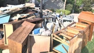 Houston homeowners cleaning up, battling looters