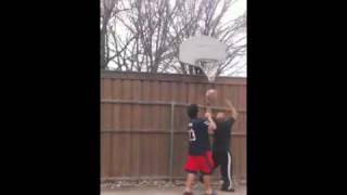 Old man beats curly headed boy bad in basketball