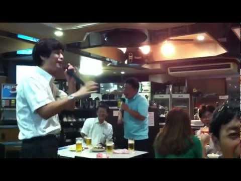 Japanese salaryman singing karaoke