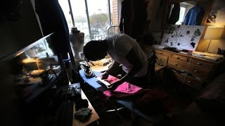 High-end fashion designer lives modest life in Boston