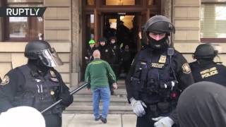 Protesters storm Portland City Council calling for mayor's resignation