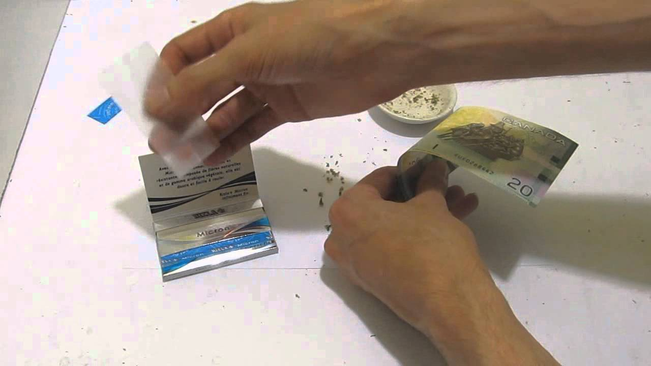 How to roll a joint with MONEY! Using a bill as a rolling ...