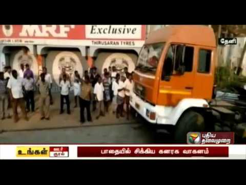 Heavy weight lorry struck in temporary road at Periyakulam