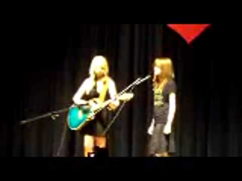 Guitar Monks student Kayla Crews on guitar at the Church Hill Middle School talent show.