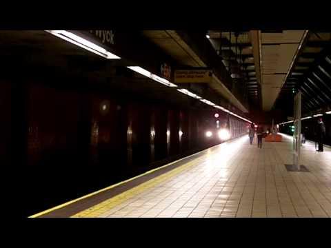 [sample Kodak Zi8] E train R160A-2 arrives at the Jamaica/Van Wyck station