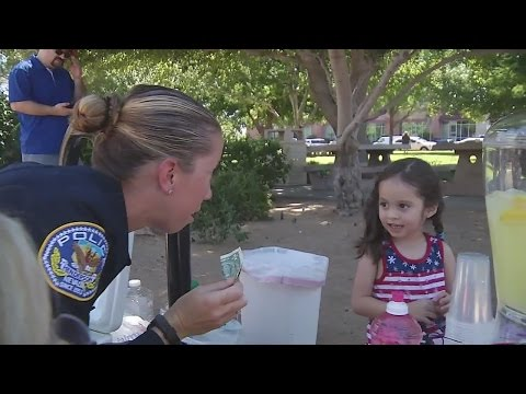 Little girl shows appreciation to local police with lemonade stand