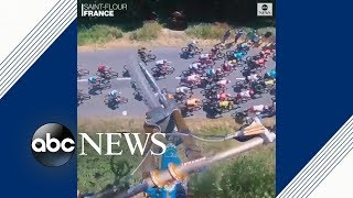 Daredevil mountain biker jumps over Tour de France | ABC News