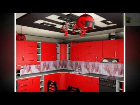колоритный дизайн кухни с красными фасадами и красными светильниками.