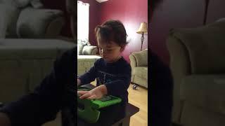 Toddler plays iPad game