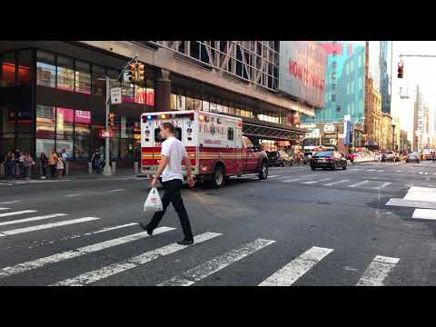 FDNY EMS AMBULANCE RESPONDING ON 8TH AVENUE IN HELL'S KITCHEN AREA OF MANHATTAN IN NEW YORK CITY.