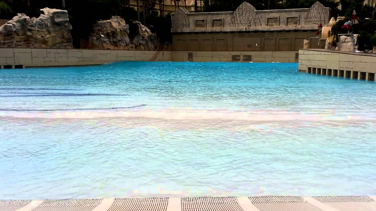 Mandalay bay hotel las vegas wave pool youtube for Nspi pool show vegas