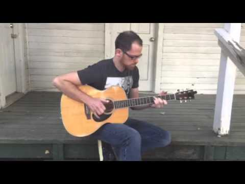 Richard Keelin - Playing a quick snippet on the porch of Merle a Travis. Martin OM35