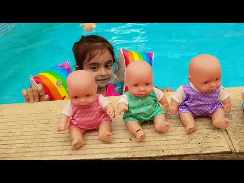 Learn colors with Baby dolls at Swimming Pool