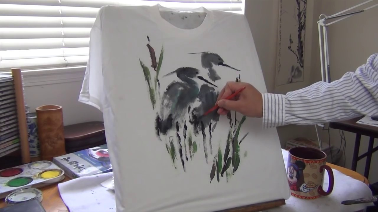 8f1928b2f38 Henry Li showing how to paint a T-shirt with liquid acrylic paints ...