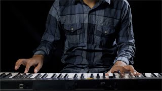 Young Indian talented boy playing an electronic keyboard instrument