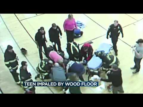 Girl playing basketball impaled by Middleton fieldhouse court