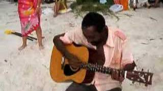 Crazy guy sings songs on Seychelles Beach
