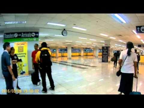 Manila, Philippines:  Leaving plane ; passing immigration in Terminal 3